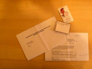 Package content (DV tape, business card, GPS coordinates)