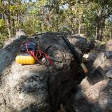 An axe and a multimeter on a rock