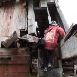 Tammy climbs up a wreck