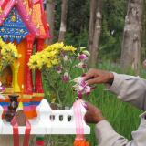 The brahman blesses the spirit house