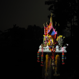 The spirit house at night