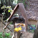 Lo-fi spirit house near a parking at the dam