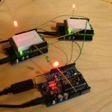 Three Arduinos handshaking in circle